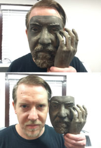 Mask of man shown in bronze, before patina was applied.