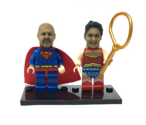 A couple as Superman and Wonderwoman Legos using our Lego compatible heads!