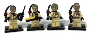 Lego compatible heads on four female Ghostbuster figures